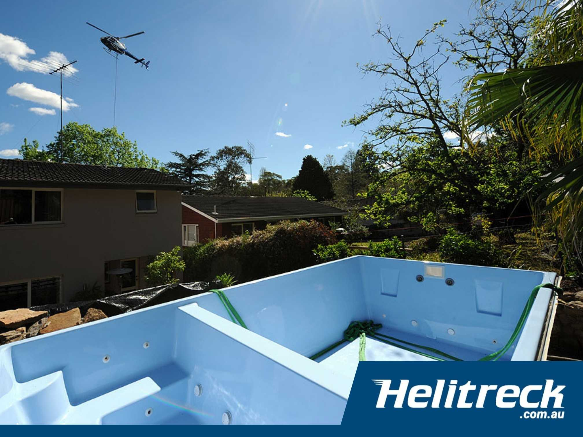 Helicopter crane installing a spa pool